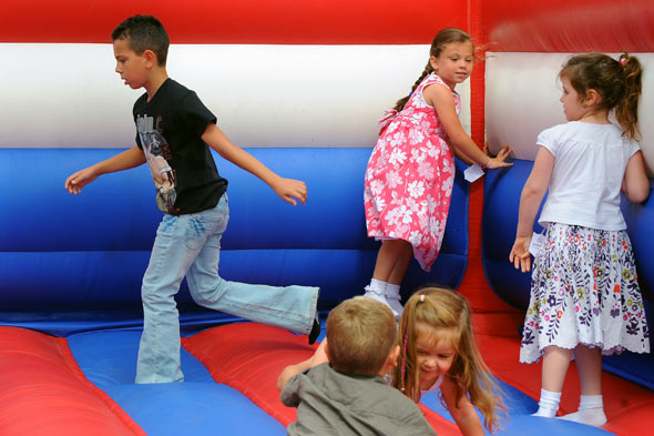 Three children injured as bouncy castle is blown into the air