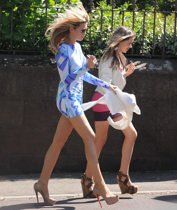 Super skinny Abbey Clancy in micro frock at christening