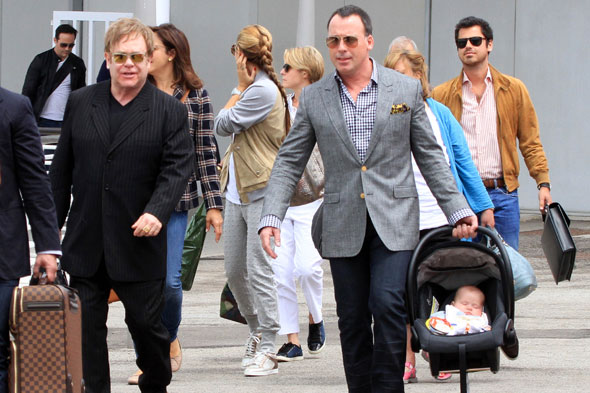 Elton John and David Furnish jet off with baby Zachary