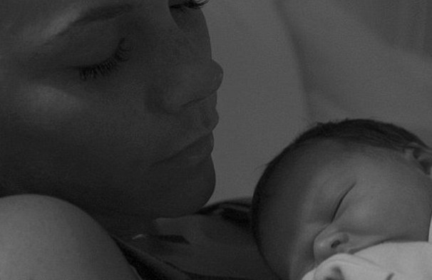 First pic! Victoria Beckham shows off new baby Harper Seven on Twitter