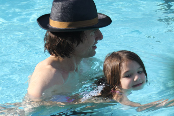 Suri Cruise wears swimsuit for dip whilst Tom keeps his hat on