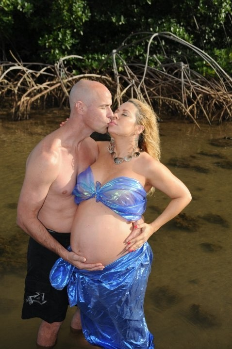 Nothing is more romantic than a kiss, with your bump out, in a swamp