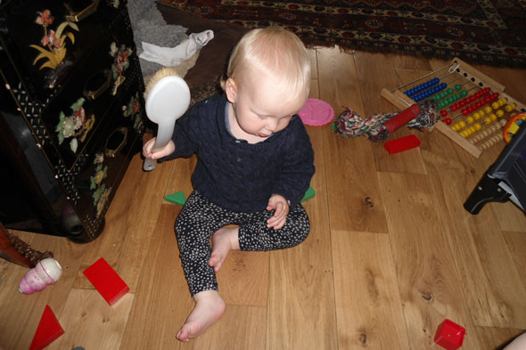 Toddler baby Diana hitting her toys