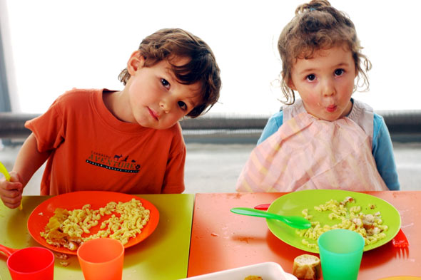 Children eating a nursery meal