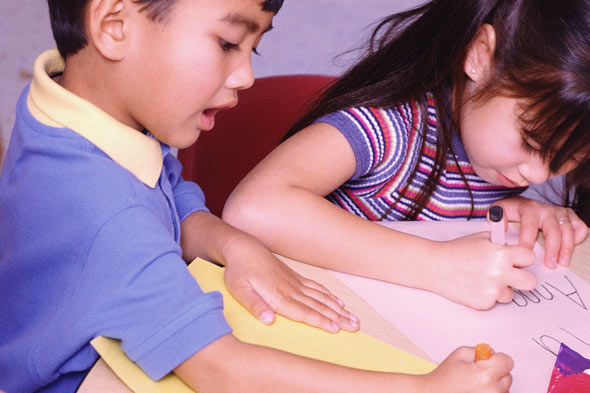 Children in classroom in ability groups