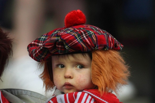 Child with ginger hair and tartan hat