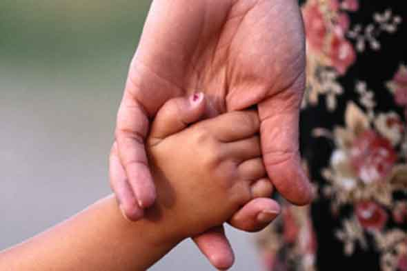 Child and au pair hand in hand