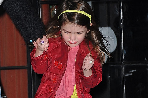 Suri Cruise in bright red lipstick horror