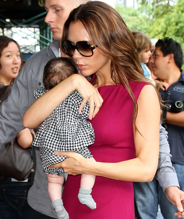 Victoria Beckham shows off baby Harper at New York Fashion Week