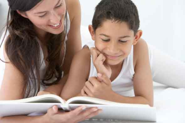 Boy reading with parent