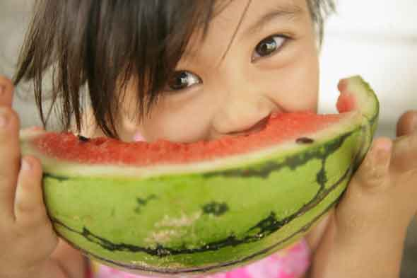 Help! My child is a fussy eater. Child eating a watermelon