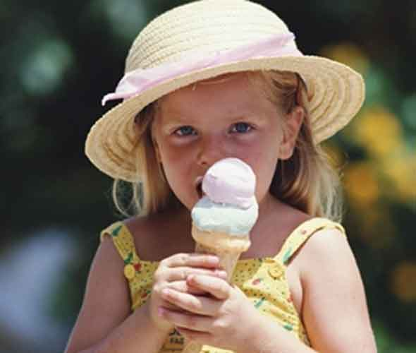 Little girl licking ice cream