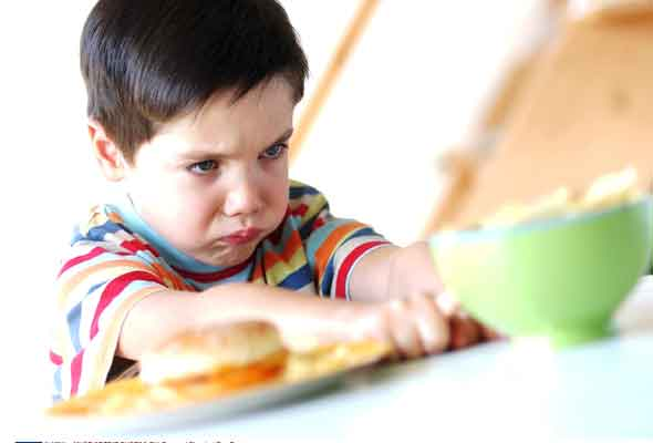 Fussy eater child refusing food