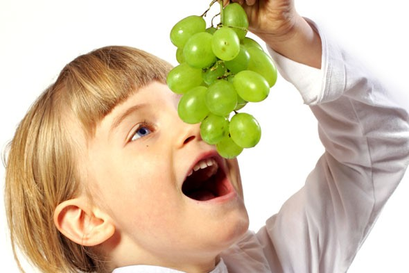 Child eating grapes
