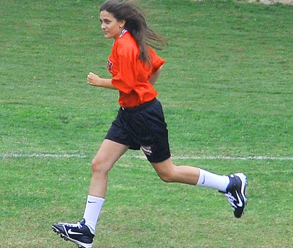 Michael Jackson's daughter Paris has a laugh playing football