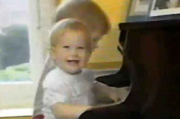 Prince William, aged 3, and Prince Harry, one, play the piano together