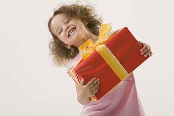 Happy child holding present