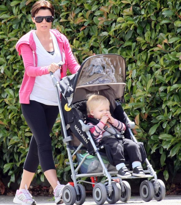 Dannii Minogue takes bonny baby Ethan out for a stroll