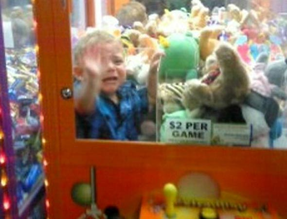 Hilarious pic: Toddler gets trapped in toy machine