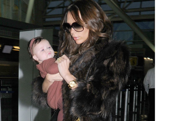 Harper Beckham and Victoria Beckham in fur coat
