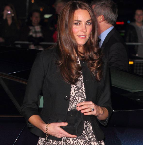Kate Middleton holds bag over her tummy sparking more pregnancy rumours