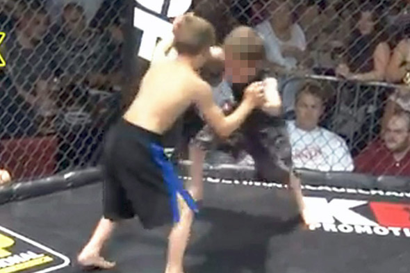 Children filmed cage fighting