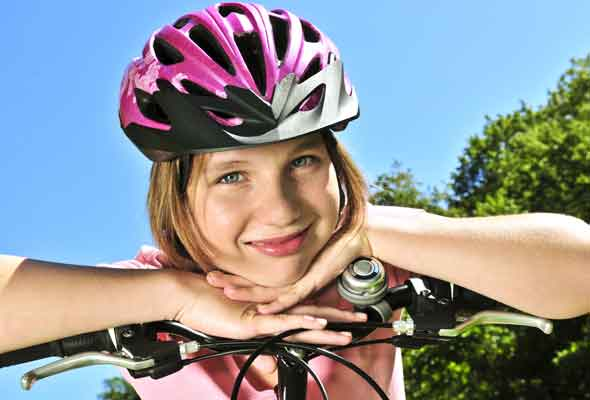 Girl bike riding: teens and exercise Rex Features