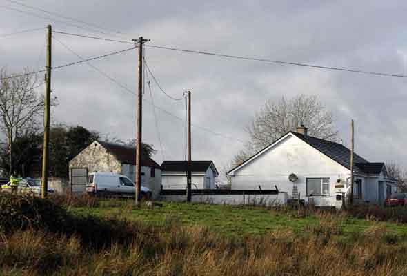 The remote bungalow where Trevor Wallwork and his children were found dead in front of the TV