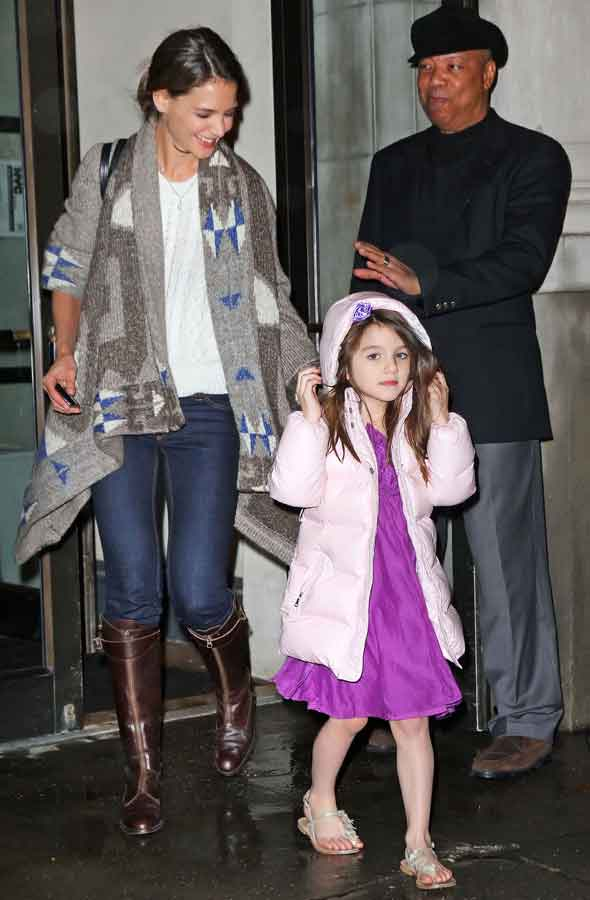 Suri Cruise wears a coat...