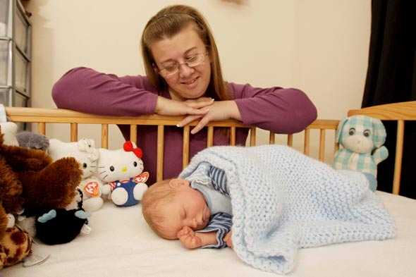 Mum treats re-born doll like a real baby despite having a daughter