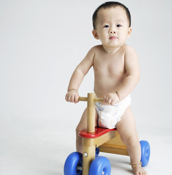 11 months, trying out a tricycle