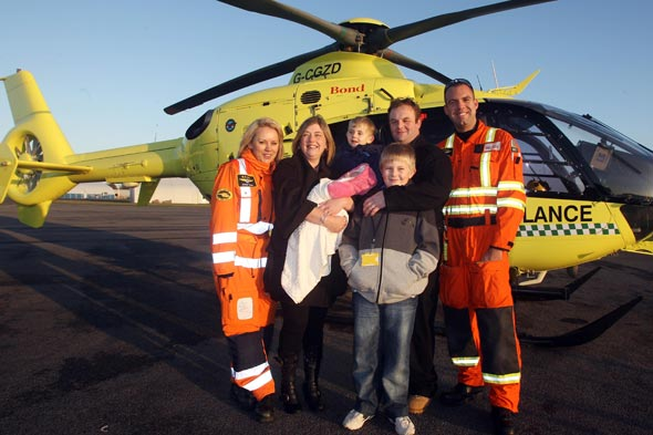 Toddler who 'died' for six minutes reunited with life-saving paramedics
