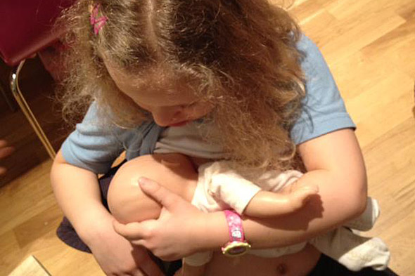 Facebook brands photos of little girls 'breastfeeding' dolls obscene content