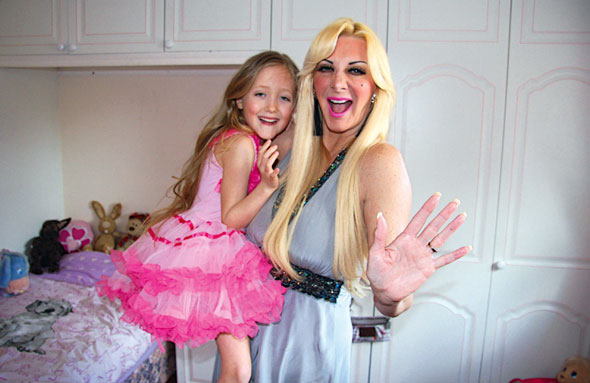 Human Barbie mum gives seven-year-old a boob job voucher...