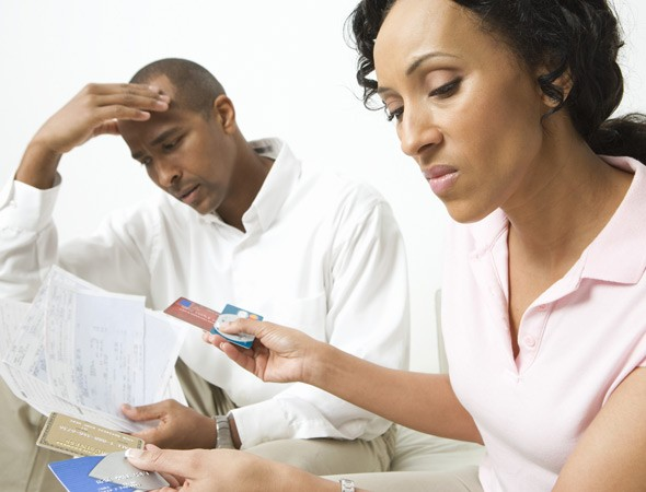 Couple worried by credit card bills: Family debts up by 48% in one year. 