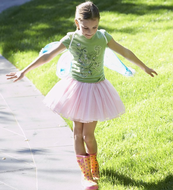 Child wearing fairy wings and wellies