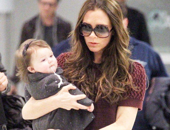 Harper Seven Beckham vomits while being held by mother Victoria Beckham