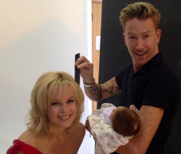 Amanda Holden takes new baby Hollie Rose to work on glamourous photo shoot