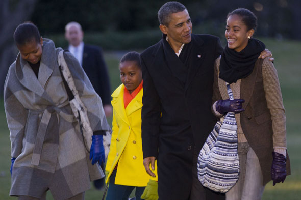 Barack Obama, his wife Michelle and daughters