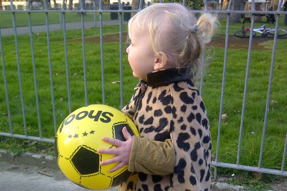 Toddler Diana with her beloved ball