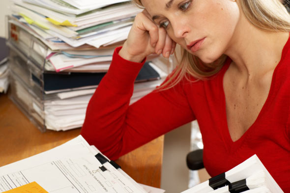 Anxious woman looking at paperwork