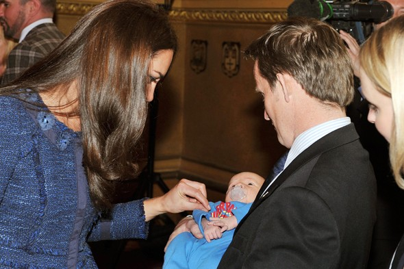 Is Kate Middleton broody? Duke and Duchess of Cambridge coo over baby at charity event
