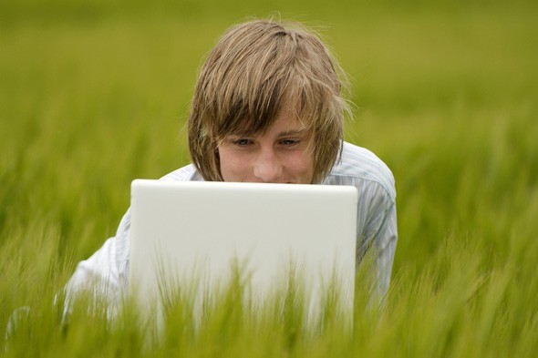 Teen boy using Apple mac