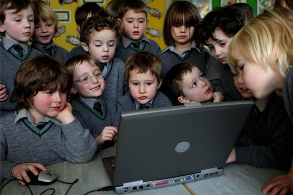Schoolchildren on computer