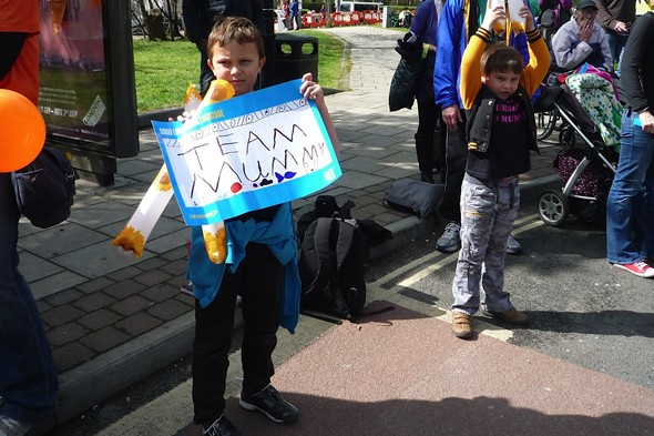 Ursula's sons waiting to cheer her on the London marathon