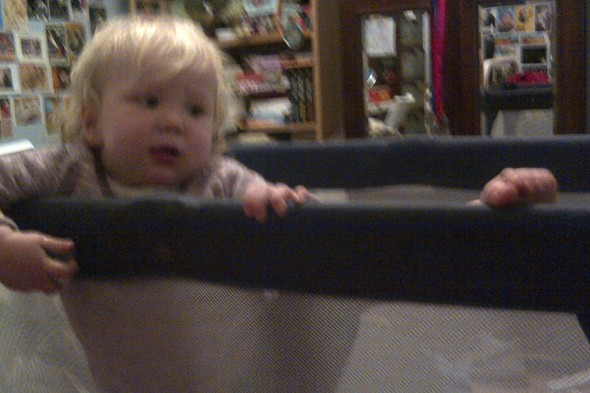 Baby Diana makes her escape from a travel cot