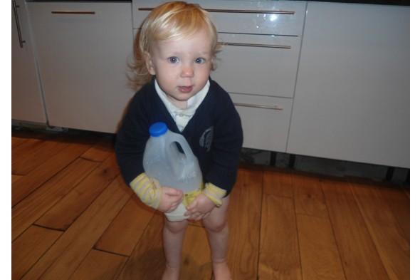 Toddler Diana with bottle of milk