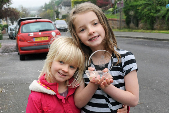 Sister act: Girl, six, who saved toddler sister's life from runaway car wins hero award