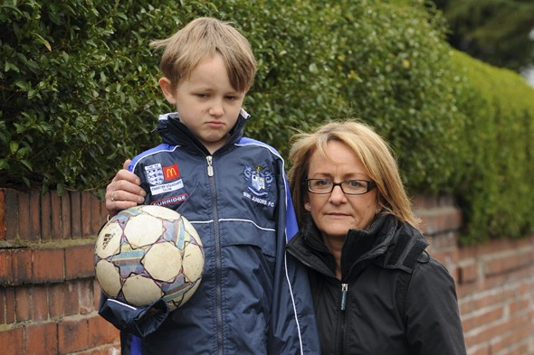 Boy banned by police from playing football outside his house