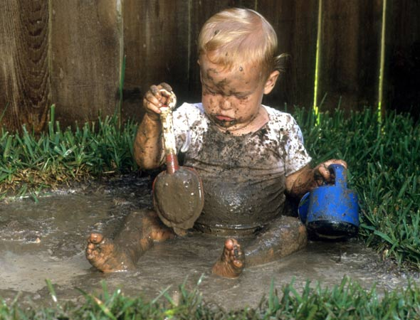 Toddler in mud